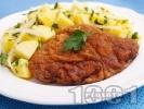 Рецепта Виенски шницел от свинско каре (контра филе) паниран в брашно, галета и яйца на тиган